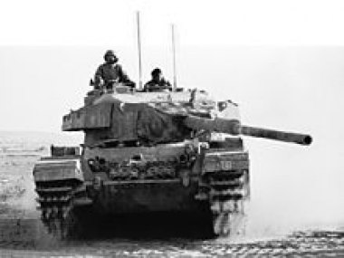 [Image: 220px-israeli_tank_battles_egyptian_forces_in_the_sinai_desert_-_flickr_-_israel_defense_forces.jpg]